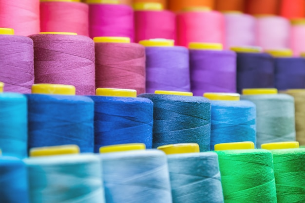 Different colors of thread, textile, for clothing manufacture