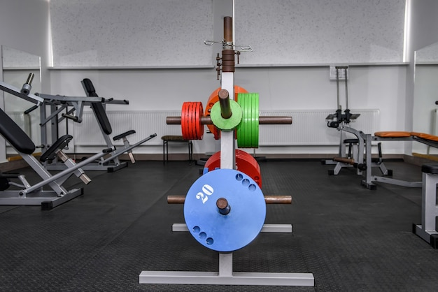 Different colour weights for barbells in gym