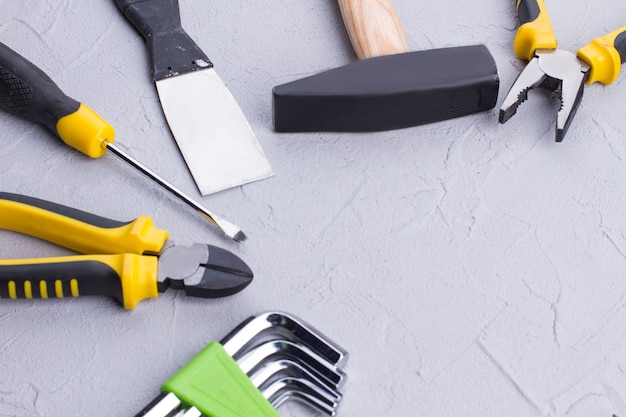Different construction tools on gray background