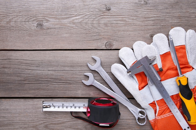 Different construction tools on grey background wooden  with copy space.