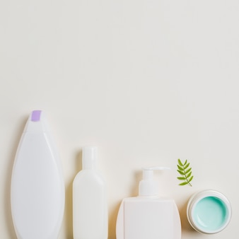 Different cosmetic products for personal care on white backdrop