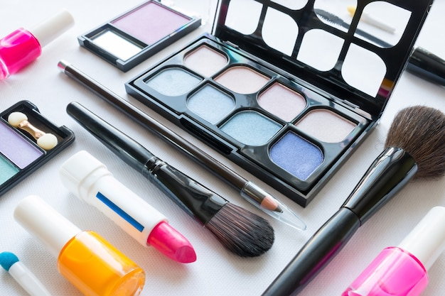 Different cosmetics for makeup on a white background