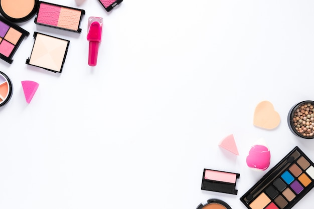 Different cosmetics scattered on table