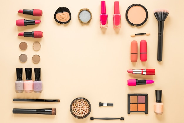 Different cosmetics types on beige table