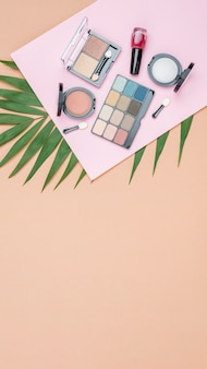 Different cosmetics with copy space on beige background