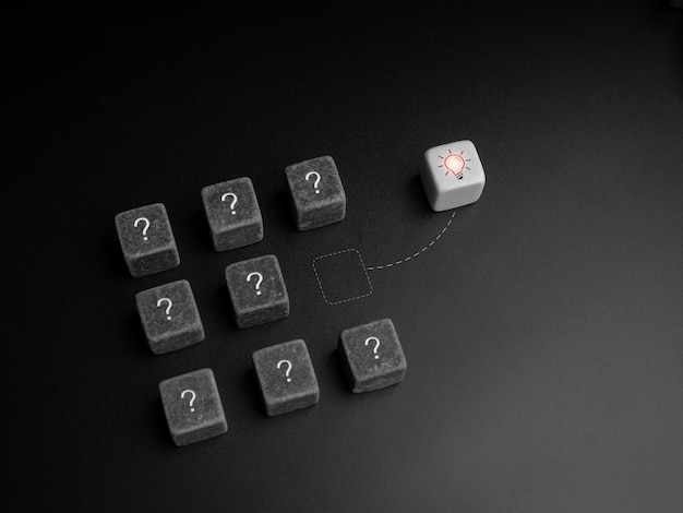 Different creative ideas, think outside the rules, survival and solving problem concepts. light bulb icon on white dice changing direction out of problem symbol on black dice group on dark background.