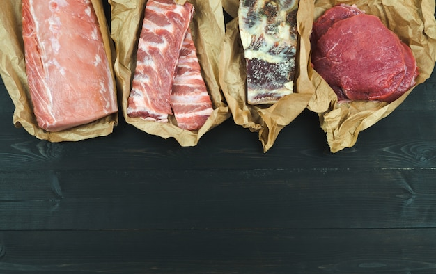 Different cuts of meat, fresh and cured copy space.