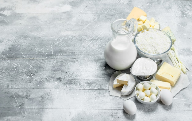 Different dairy products . on a rustic table.