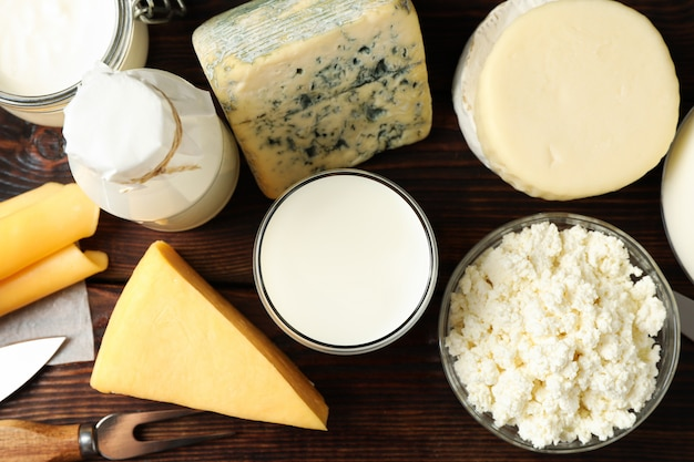 Different dairy products on wooden space, top view