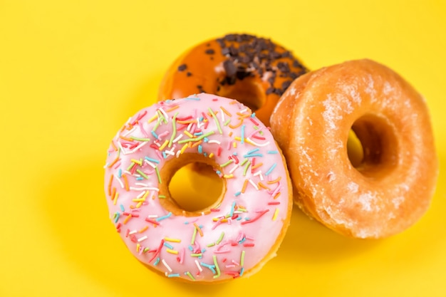 Different donuts with frosting and sprinkles
