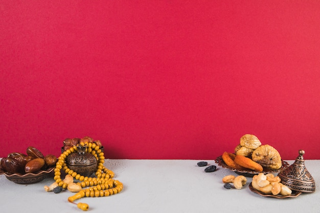 Different dried fruits with nuts and beads