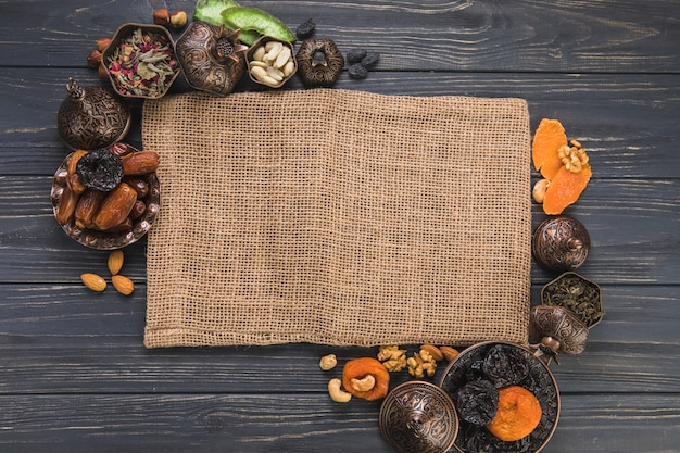 Different dried fruits with nuts and canvas