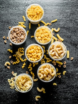 Different dry pasta in bowls