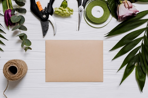 Different equipment and paper on floristtable