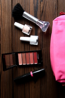 A different female cosmetics on wooden background
