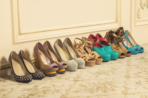 Different female shoes on high heels