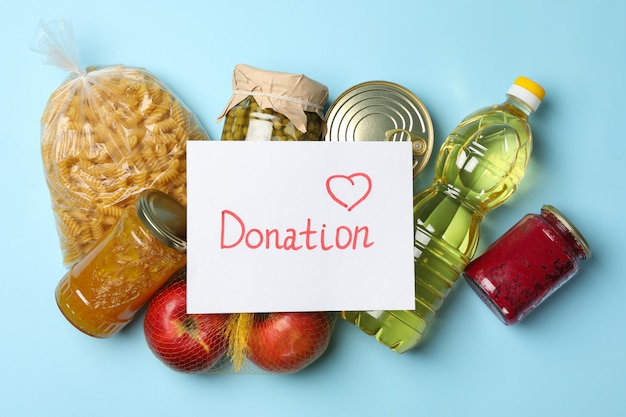 Different food on blue space, top view. donation concept