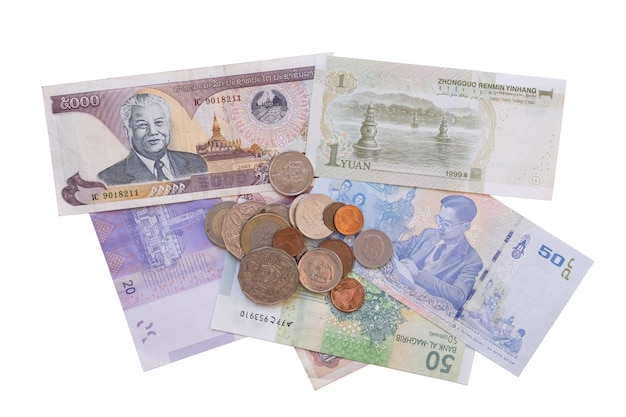 Different foreign currencies isolated on white
