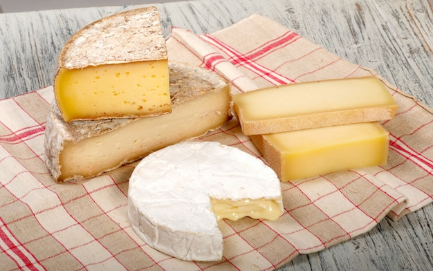 Different french cheeses on a towel