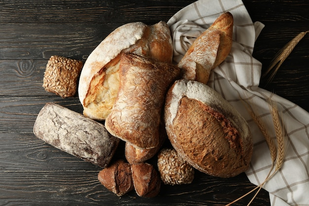 Different fresh bakery products on wooden background