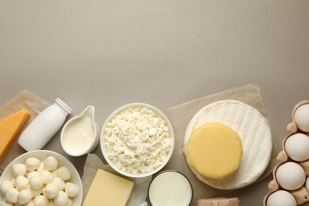 Different fresh dairy products on gray background, space for text