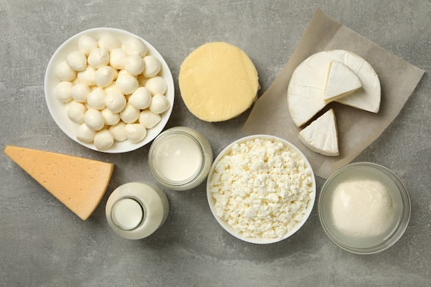 Different fresh dairy products on gray background, top view