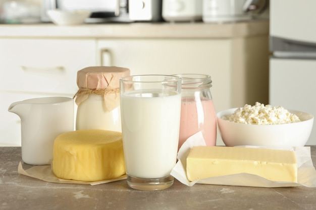 Different fresh dairy products on gray table