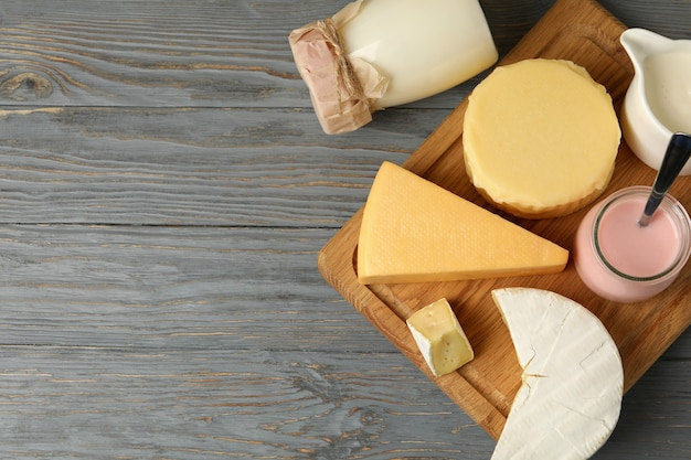 Different fresh dairy products on gray wooden background