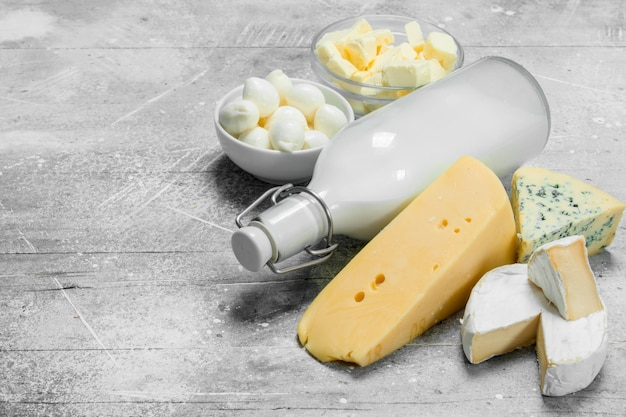 Different fresh dairy products. on a rustic table.