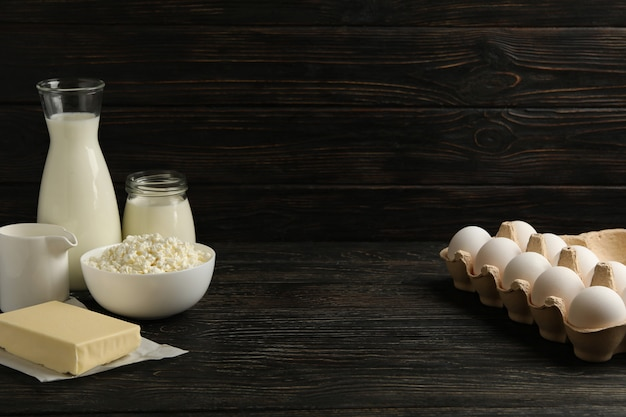 Different fresh dairy products on wooden background, space for text
