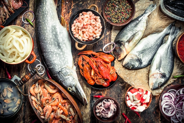 Different fresh seafood. on a wooden background.