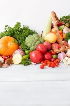 Different fresh vegetables in basket.