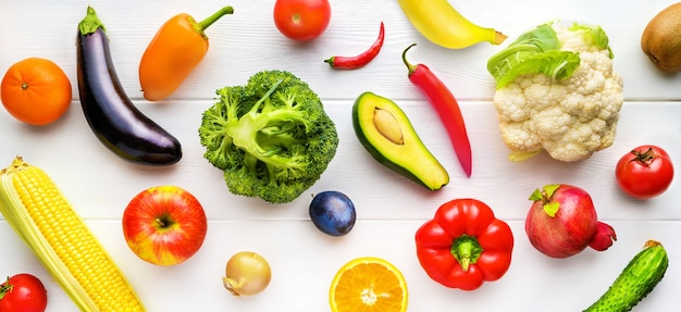 Different fruits and vegetables on white wooden table on the kitchen. healthy food background. top view, flat lay