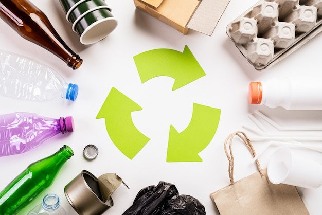 Different garbage materials with recycling symbol. recycle, environment concept