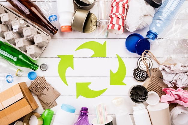 Different garbage materials with recycling symbol
