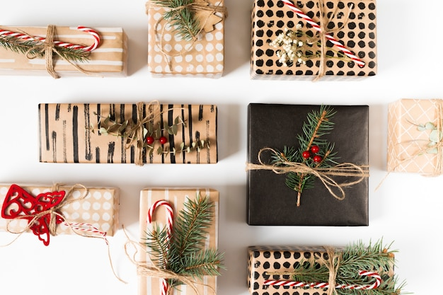 Different gift boxes with branches on white table