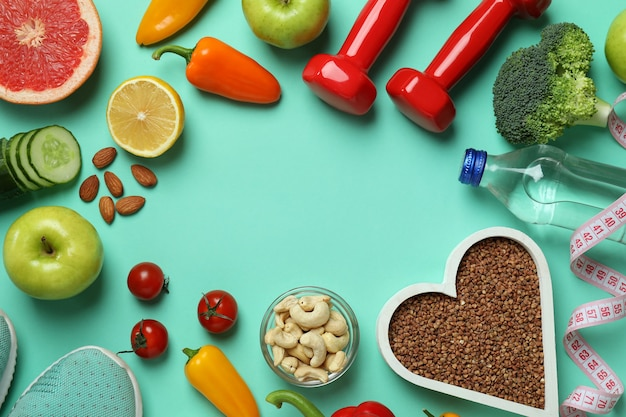 Different healthy lifestyle accessories on mint background