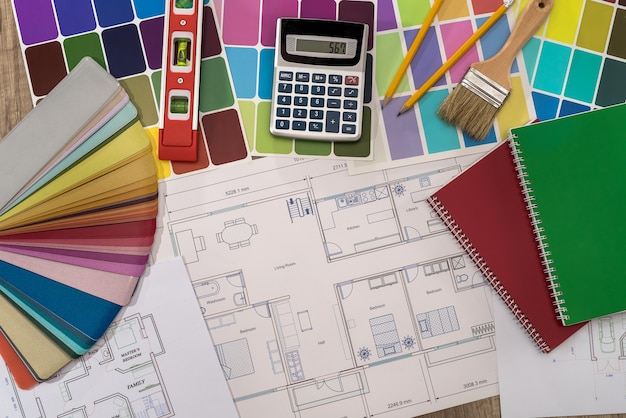 Different house plans with colour palette on table