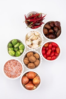 Different ingredients in white bowls