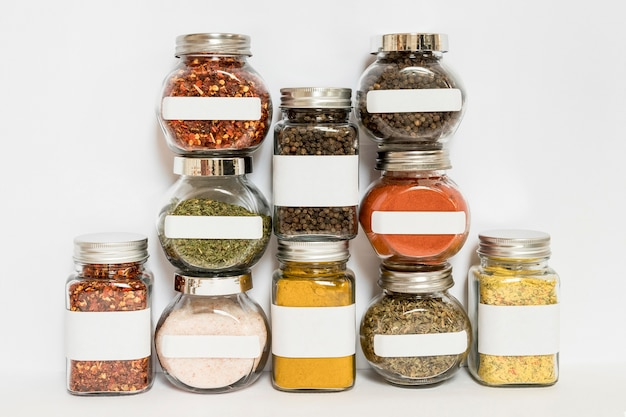 Different jars with spices and herbs