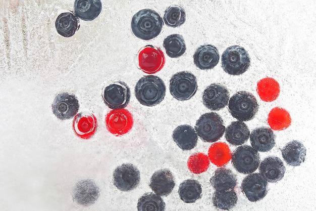 Different juicy berries frozen in ice. vitamin healthy food