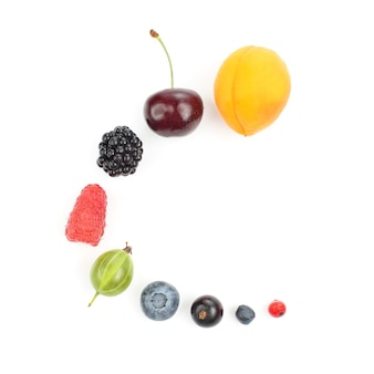 Different juicy berries laid out in order on a white background. healthy vitamin food