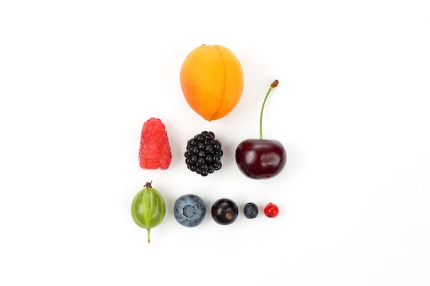 Different juicy berries on a white table