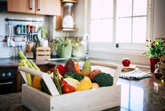 Different kind of fresh raw vegetables in white red yellow green colors healthy eating concept