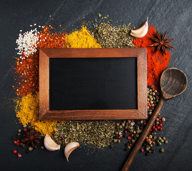 Different kind of spices and blackboard