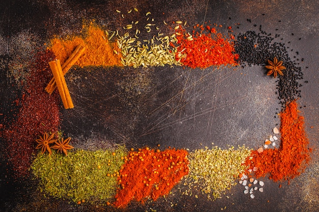 Different kind of spices on dark background.