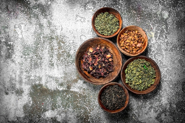 Different kinds of fragrant tea in bowls.