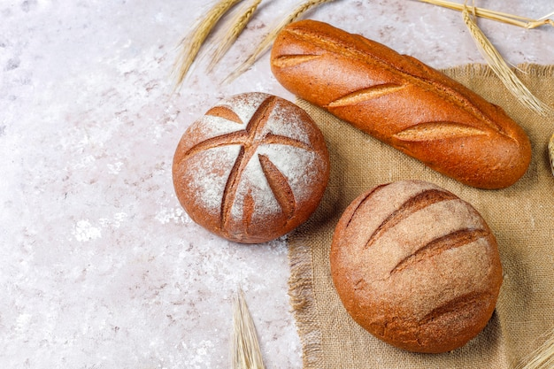 Different kinds of fresh bread as background