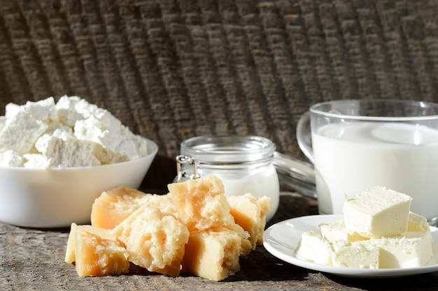 Different kinds of fresh dairy products on a wooden table closeup