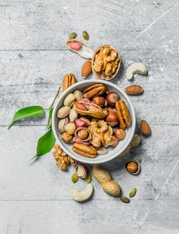 Different kinds of nuts in bowl .